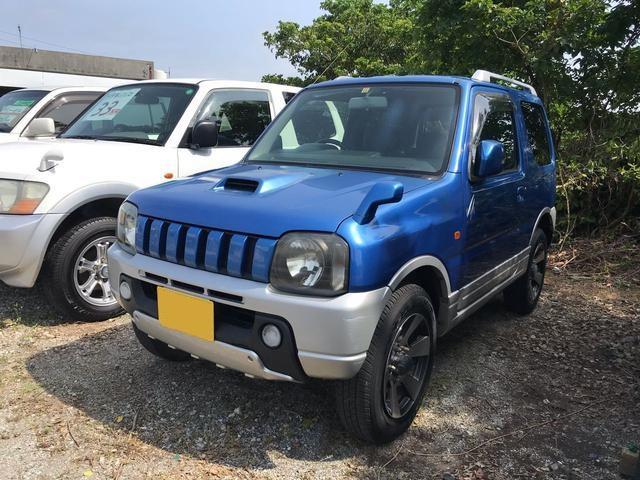 沖縄の中古車 スズキ ジムニー 車両価格 23万円 リ済込 平成14年 19.4万km キプロスブルーメタリックII