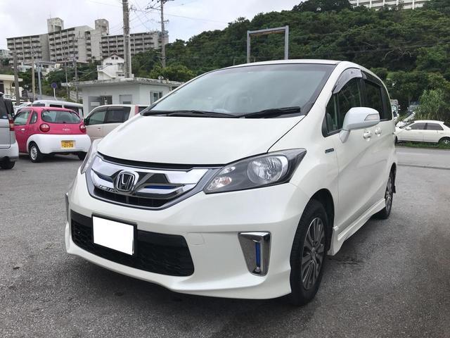 沖縄の中古車 ホンダ フリードハイブリッド 車両価格 79万円 リ済込 2011(平成23)年 11.5万km ホワイト
