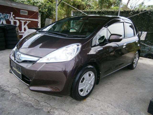 沖縄の中古車 ホンダ フィットハイブリッド 車両価格 39万円 リ済込 2013(平成25)年 8.3万km ブラウンM