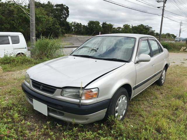 沖縄の中古車 トヨタ カローラ 車両価格 9万円 リ済込 年式不明 6.6万km ベージュ