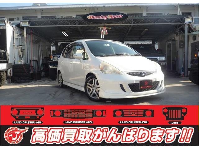 沖縄の中古車 ホンダ フィット 車両価格 19万円 リ済別 2006(平成18)年 14.5万km ホワイト