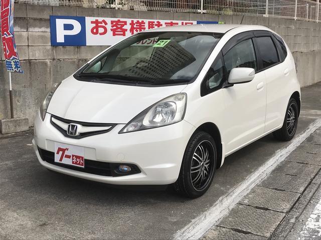 沖縄の中古車 ホンダ フィット 車両価格 38万円 リ済込 2009(平成21)年 6.8万km パールホワイト