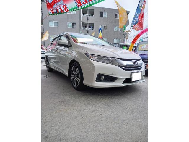 沖縄の中古車 ホンダ グレイス 車両価格 122万円 リ済別 2015(平成27)年 7.3万km パールホワイト