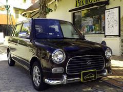 沖縄の中古車 ダイハツ ミラジーノ 車両価格 28万円 リ済込 平成12年 8.5万K ライトブラウンM