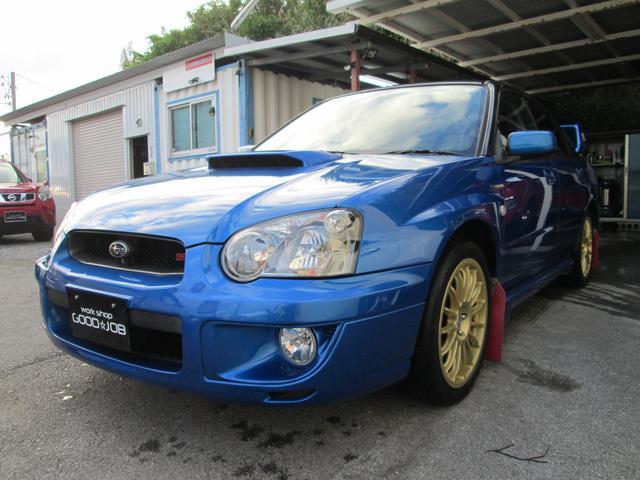沖縄県の中古車ならインプレッサ WRX 水平対向エンジン インタークーラーターボ MT5速 4WD 純正HID 大型リアウイング OZレーシング17AW