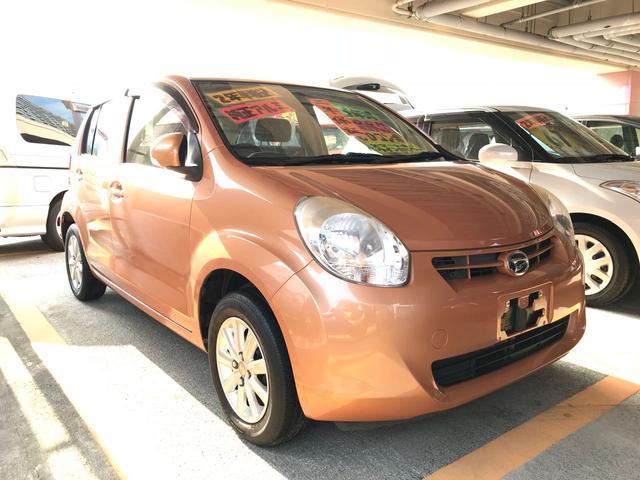 沖縄の中古車 ダイハツ ブーン 車両価格 49万円 リ済込 2013(平成25)年 8.2万km オレンジ