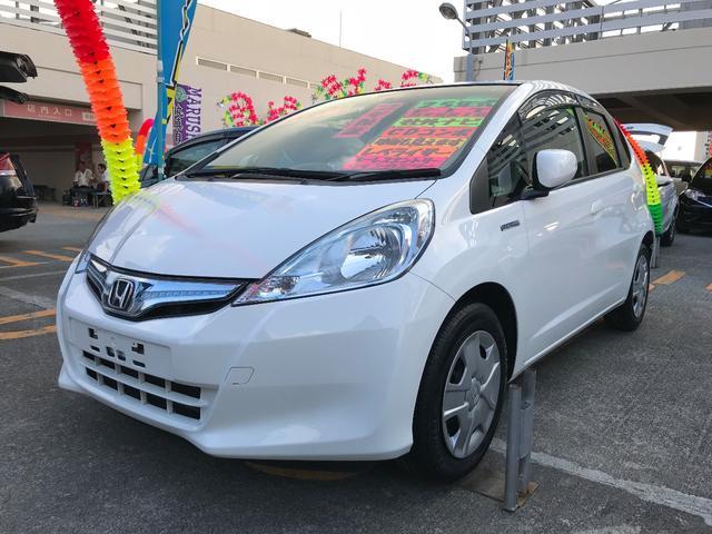 沖縄の中古車 ホンダ フィットハイブリッド 車両価格 59万円 リ済込 2013(平成25)年 9.6万km ホワイト