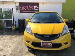 沖縄の中古車 ホンダ フィット 車両価格 34万円 リ済込 平成19年 11.2万K イエローII