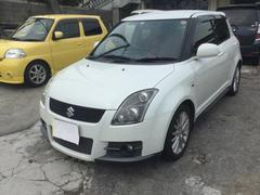 沖縄の中古車 スズキ スイフト 車両価格 39万円 リ済込 平成18年 17.8万K パールホワイト