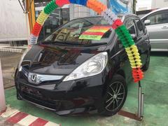 沖縄の中古車 ホンダ フィットハイブリッド 車両価格 69万円 リ済別 平成23年 7.7万K ブラックIII