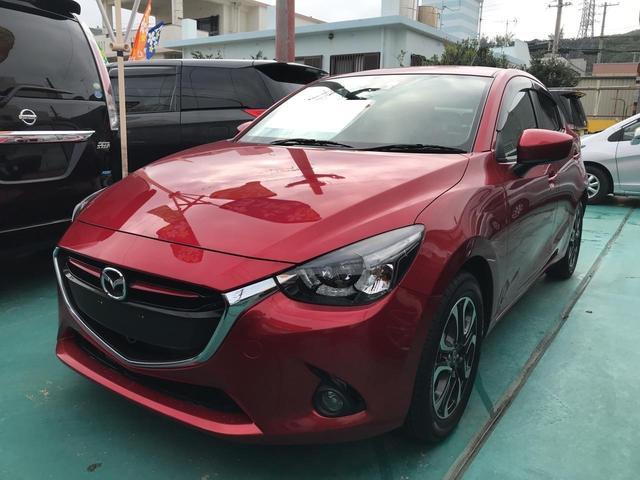 沖縄の中古車 マツダ デミオ 車両価格 129万円 リ済込 平成27年 5.8万km レッド