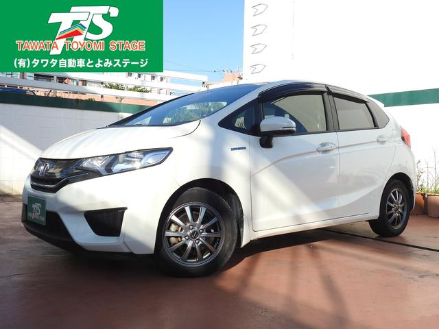沖縄の中古車 ホンダ フィットハイブリッド 車両価格 103万円 リ済込 平成26年 5.3万km パールホワイト