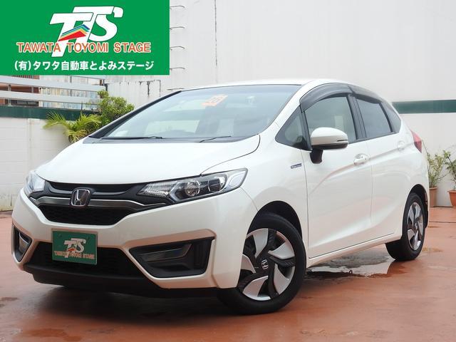 沖縄の中古車 ホンダ フィットハイブリッド 車両価格 109万円 リ済込 2014(平成26)年 6.3万km パールホワイト