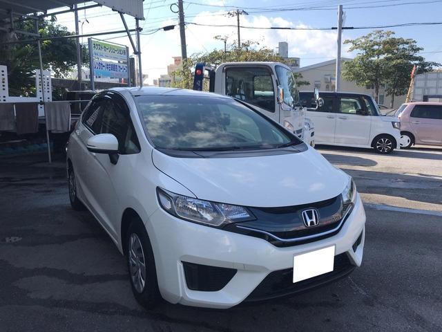 沖縄の中古車 ホンダ フィット 車両価格 49万円 リ済別 2015(平成27)年 4.1万km パールホワイト