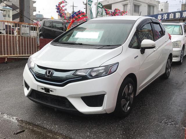 沖縄の中古車 ホンダ フィットハイブリッド 車両価格 103万円 リ済込 2013(平成25)年 4.6万km パールホワイト