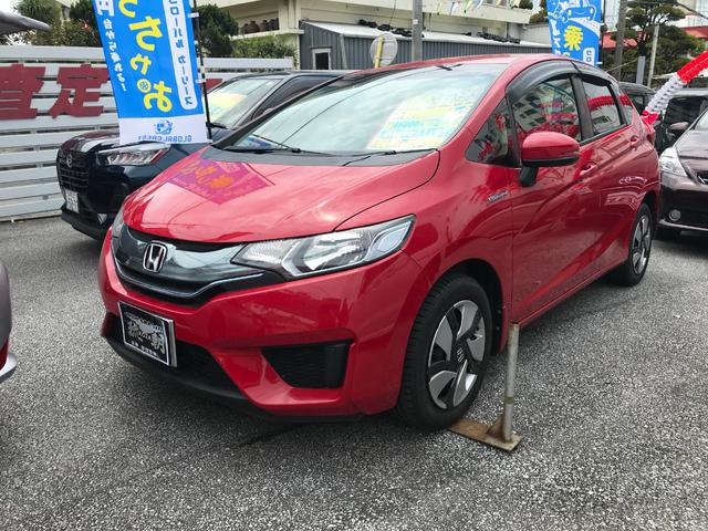 沖縄の中古車 ホンダ フィットハイブリッド 車両価格 108万円 リ済別 2014(平成26)年 4.6万km レッドM