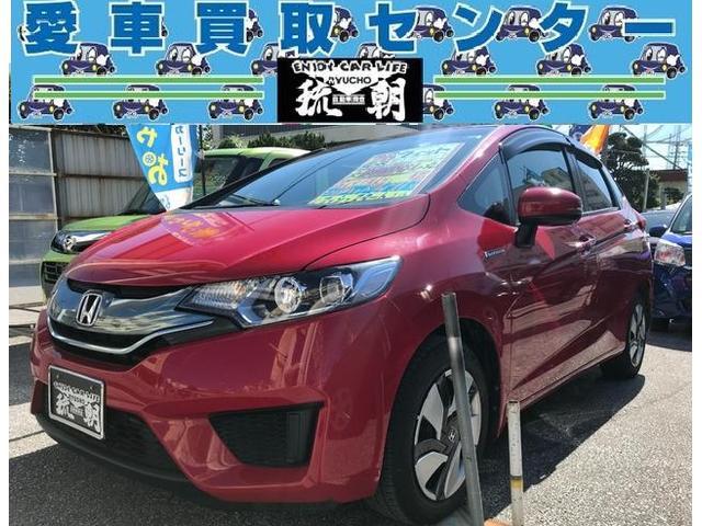 沖縄の中古車 ホンダ フィットハイブリッド 車両価格 108万円 リ済込 2014(平成26)年 4.9万km レッド