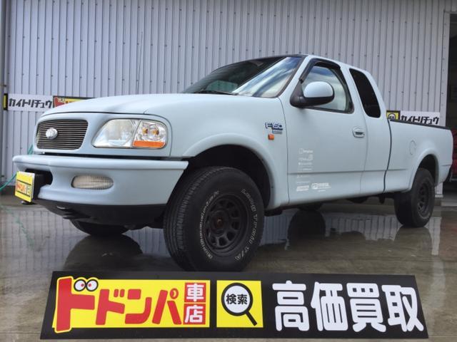 沖縄の中古車 フォード フォード F-150 車両価格 49万円 リ済込 2002年 14.3万km 艶げし水色