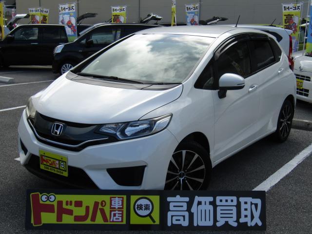 沖縄の中古車 ホンダ フィット 車両価格 68万円 リ済込 2015(平成27)年 8.2万km パールホワイト