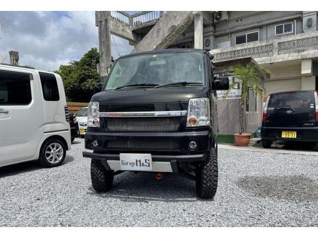 沖縄県うるま市の中古車ならエブリイワゴン JP パートタイム4WD 5MT リフトアップ 社外15インチ