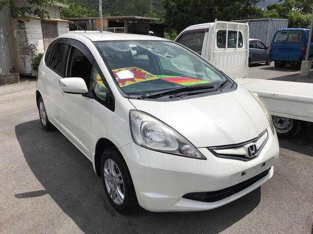 沖縄の中古車 ホンダ フィット 車両価格 49万円 リ済込 2010(平成22)年 8.8万km パールホワイト
