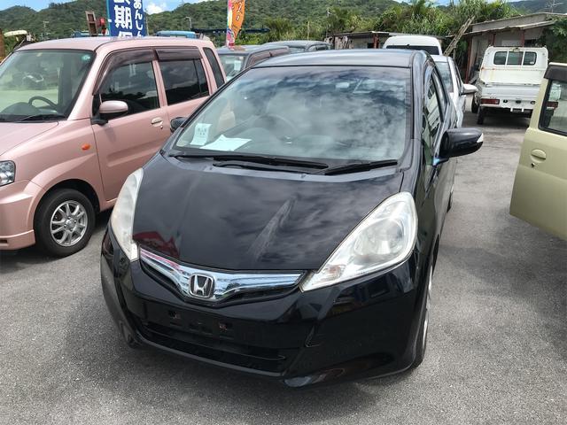 沖縄の中古車 ホンダ フィットハイブリッド 車両価格 60万円 リ済込 2011(平成23)年 7.6万km ブラック