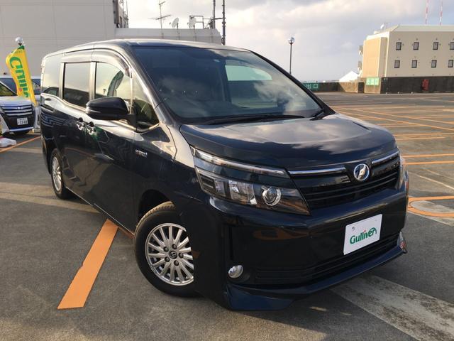 沖縄県の中古車ならヴォクシー ハイブリッドV 両側パワースライドドア・バックカメラ・リアモニター・電動格納ミラー・Bluetooth・フルセグTV・LEDヘッドランプ