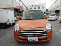 沖縄の中古車 ダイハツ ミラジーノ 車両価格 24万円 リ済込 平成19年 12.0万K オレンジ