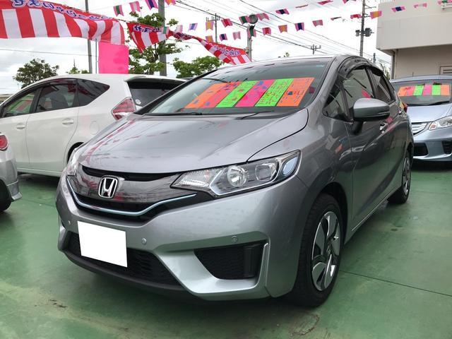沖縄の中古車 ホンダ フィットハイブリッド 車両価格 109万円 リ済別 平成26年 6.2万km シルバー