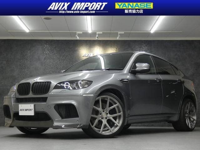 BMW X6 M ベースグレード ベージュ革 カーボンルーフ スポイラー デュフェザー 純正HDDナビ地デジBカメラ HUD パークディスタンスコントロール ヘッドアップディスプレイ 社外22AW パワートランク 禁煙車 本土仕入