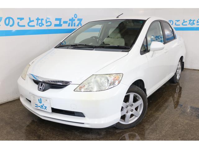 沖縄の中古車 ホンダ フィットアリア 車両価格 15万円 リ済別 2003(平成15)年 13.3万km タフタホワイト