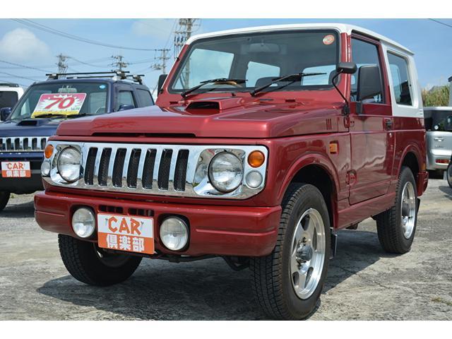 沖縄の中古車 スズキ ジムニー 車両価格 73万円 リ済込 1997(平成9)年 11.5万km ダークレッド/ホワイト2トン