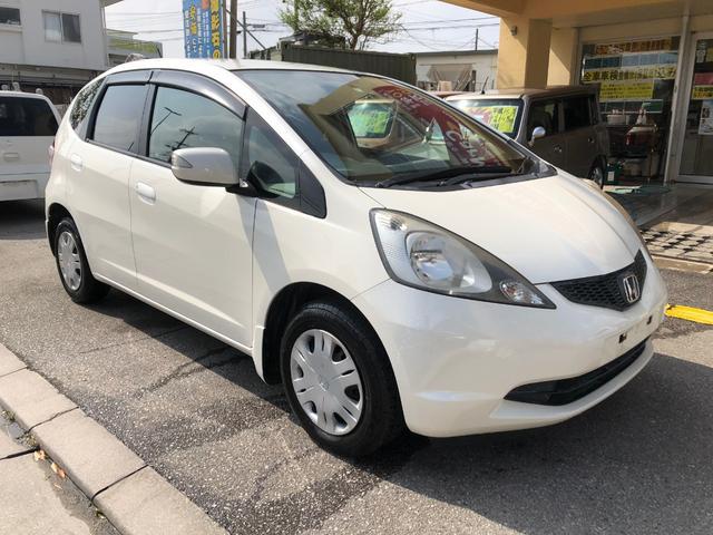 沖縄の中古車 ホンダ フィット 車両価格 34万円 リ済込 平成22年 14.8万km パールホワイト