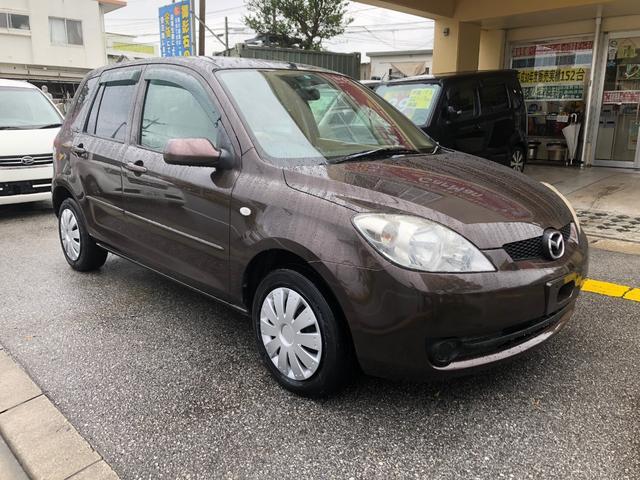 沖縄の中古車 マツダ デミオ 車両価格 29万円 リ済込 平成18年 14.1万km ブラウンM