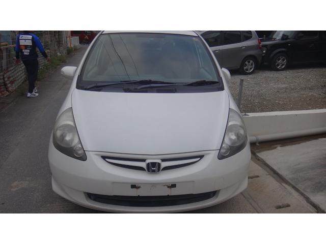 沖縄の中古車 ホンダ フィット 車両価格 5万円 リ済込 2006(平成18)年 16.4万km ホワイト