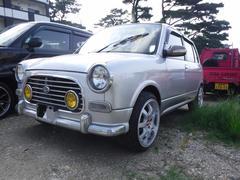 沖縄の中古車 ダイハツ ミラジーノ 車両価格 21万円 リ済込 平成14年 14.0万K ガンMII