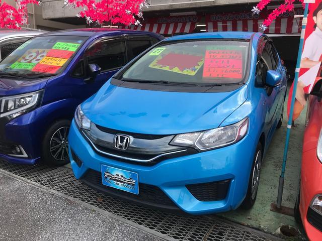 沖縄の中古車 ホンダ フィットハイブリッド 車両価格 75万円 リ済込 2015(平成27)年 3.6万km ライトブルー
