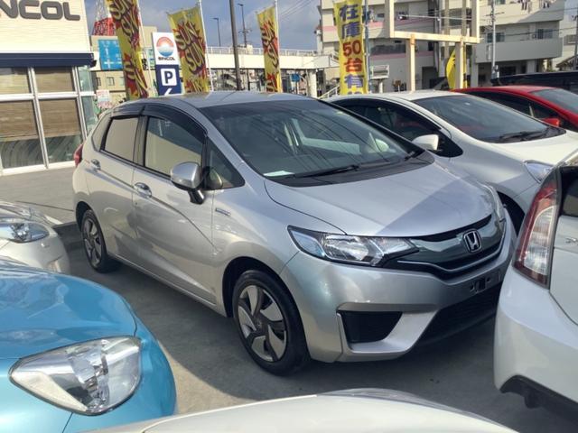 沖縄県宜野湾市の中古車ならフィットハイブリッド Fパッケージ 2年修理保証