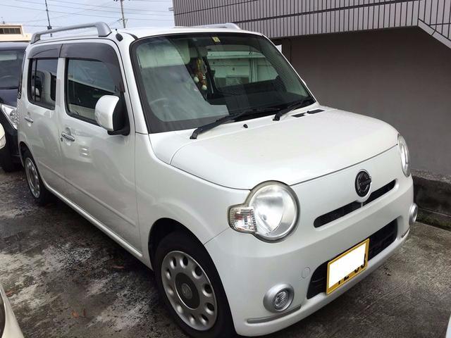 沖縄の中古車 ダイハツ ミラココア 車両価格 52万円 リ済込 平成21年 10.5万km パールホワイトIII