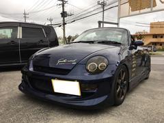 沖縄の中古車 ダイハツ コペン 車両価格 90万円 リ済込 平成16年 13.0万K DCダークブルーマイカメタリック