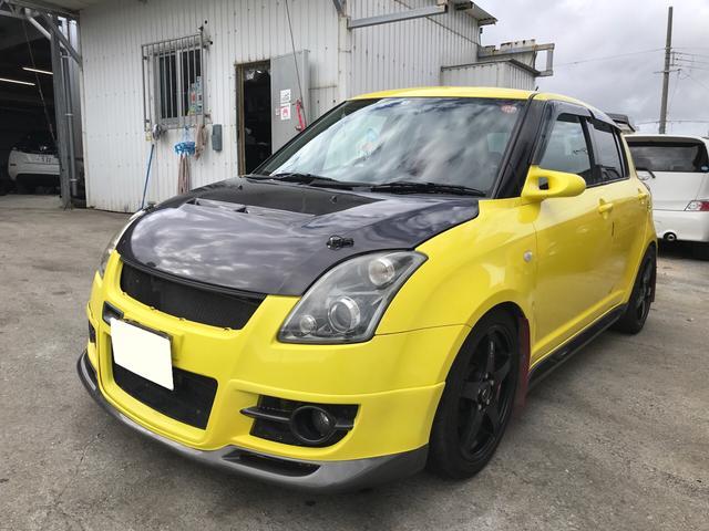 沖縄の中古車 スズキ スイフト 車両価格 65万円 リ済別 2006(平成18)年 7.2万km チャンピオンイエロー
