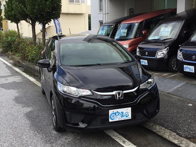 沖縄県の中古車ならフィットハイブリッド レンタカーアップ車・ナビ・ETC付・車検付・保証ロング