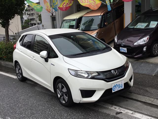 沖縄県の中古車ならフィットハイブリッド Fパッケージ・レンタアップ車・NAVI・ETC付き・保証付き