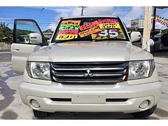 沖縄の中古車 三菱 パジェロイオ 車両価格 35万円 リ済別 平成16年 16.6万K ウォームホワイトパール