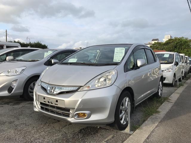 沖縄の中古車 ホンダ フィットハイブリッド 車両価格 40万円 リ済込 2011(平成23)年 9.5万km シルバー