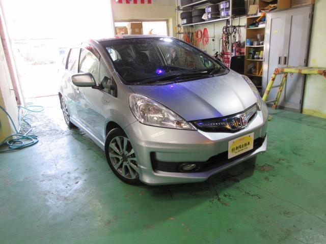 沖縄の中古車 ホンダ フィットハイブリッド 車両価格 83万円 リ済込 2012(平成24)年 8.9万km ライトブルーM