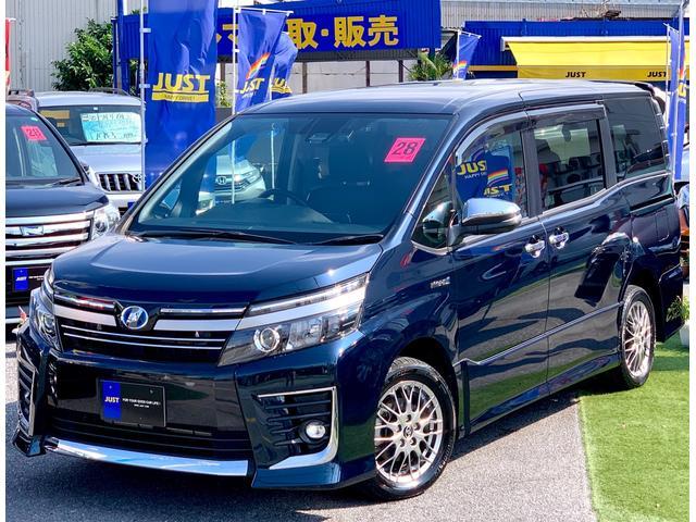 沖縄県の中古車ならヴォクシー ハイブリッドZS 煌II キラメキ2・10インチモデルBIGナビ・12インチ純正フリップダウンモニター・Wパワースライドドア・セーフティセンス・ルーフスピーカー・マルチビューガイドカメラ・・・