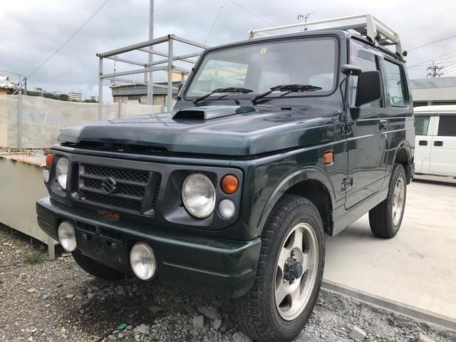 沖縄の中古車 スズキ ジムニー 車両価格 25万円 リ済込 平成9年 16.7万km ブリティッシュグリーンパール