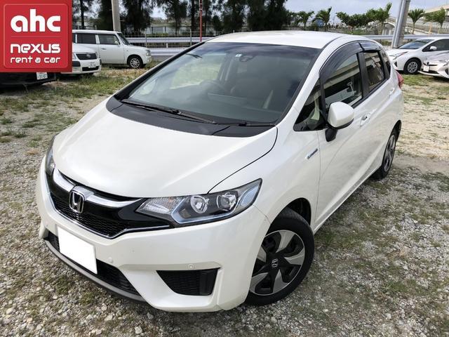 沖縄の中古車 ホンダ フィットハイブリッド 車両価格 134.5万円 リ済別 2017(平成29)年 1.9万km ホワイト