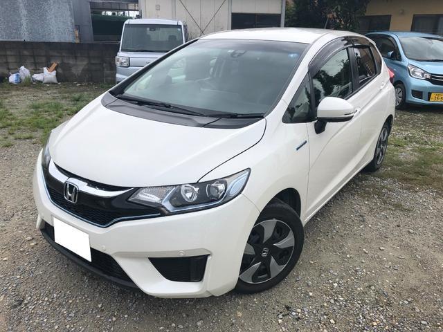沖縄の中古車 ホンダ フィットハイブリッド 車両価格 134.5万円 リ済別 2017(平成29)年 2.0万km ホワイト